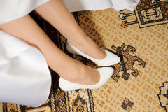 Bride's Feet on Carpet Stock Photography