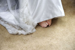 Bride's Feet. Close up of bride's feet and wedding dress Royalty Free Stock Photos
