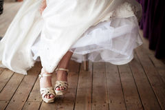 Bride's feet Stock Photo