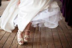 Bride's feet Stock Photo