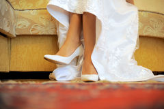 Bride's Feet in Wedding Shoes Royalty Free Stock Photography