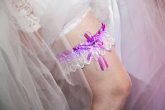 Bride's garter to the young slender leg. Stock Images
