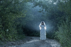 Bride`s ghost in night forest Royalty Free Stock Photography