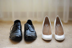 Bride's and groom's shoes. On a white carpet Royalty Free Stock Image