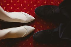 Bride's and groom's shoes on. Bride and groom shoes on carpet. wedding background Stock Photo