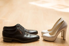 Bride's and groom's shoes Stock Photos