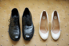 Bride's and groom's shoes Royalty Free Stock Image