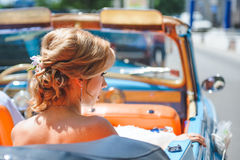 Bride`s Hairstyle. Bride in car with elegant hairstyle Stock Photography