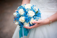Bride`s hand with a bouquet of blue Royalty Free Stock Photo