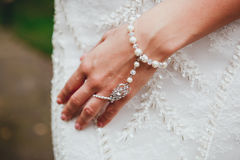 Bride's hand with a bracelet on her stomach.  Royalty Free Stock Photos