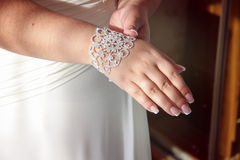 Bride's hand with a diamond bracelet Stock Photography