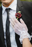 The bride`s hand on the groom`s breast Stock Photo