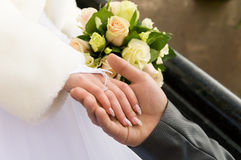Bride's hand in the hand of the groom Royalty Free Stock Images