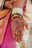 Bride's hand with henna and bangles Stock Photography
