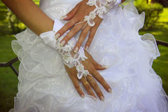 Bride's hand with a lace bracelet. Close-up of a bride's hand with a lacebracelet Stock Photo