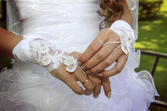 Bride's hand with a lace bracelet. Close-up of a bride's hand with a lacebracelet Stock Photography