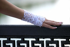 Bride's hand rests on the railing Stock Image