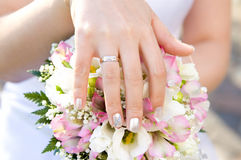 Bride's hand with a ring on a bouquet closeup. Bride's hand with a ring on a wedding bouquet closeup Stock Image