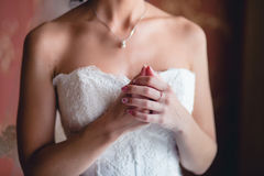 Bride's hand on shoulder Royalty Free Stock Images