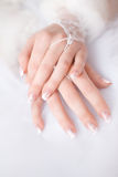 Bride's hands. Beautiful bride's hands with manicure in white gloves stock photos