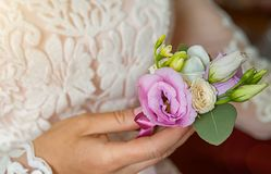 Bride`s hands with a bouquet for the groom. place for text Royalty Free Stock Photography