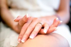 Bride's hands with expensive engagement ring Royalty Free Stock Images