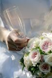 Bride's hands with flower stock images