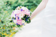 Bride`s hands hold beautiful wedding bouquet Royalty Free Stock Photos