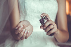 Bride's hands holding a bottle with parfumes Stock Images