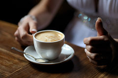 Bride's hands holding cup of coffe. E close-up Royalty Free Stock Photography