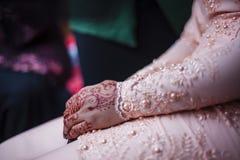 Bride's hands on lap Stock Photo