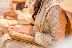 Bride's hands on lap Stock Photo