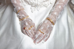 Bride's hand. S with manicure in white lace gloves Royalty Free Stock Photography