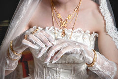 Bride's hand. S with manicure in white lace gloves Stock Photos