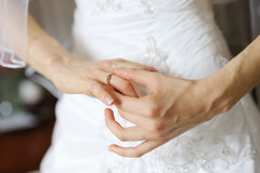 Bride's hands and a wedding or angagement ring Royalty Free Stock Photo