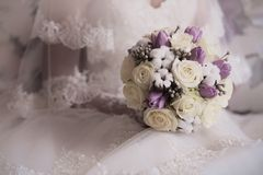 Bride's hands with wedding bouquet Royalty Free Stock Image