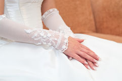 Bride`s hands on white dress stock photography
