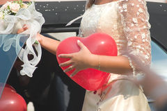 The bride's heart. A bride with a heart shaped baloon Royalty Free Stock Photos