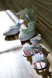 Bride's and her daughter's shoes Royalty Free Stock Photography