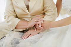 Bride's and her mother's hands Royalty Free Stock Photo