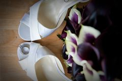 Bride's High Heel Shoes and Rings Stock Photos