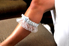 Bride's Leg With Garter. Shot of bride's leg from ankle to thigh, with garter around bride's shin Stock Photography