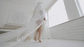 The bride`s legs go to the dress on the wedding day. Close up bride`s legs go to the dress on the wedding day stock footage