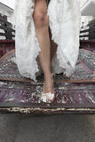 Bride's legs on a truck. Bride getting off a truck closeup under natural light Stock Photo