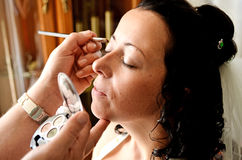 Bride´s makeup. Professional makeup artist painting bride eyes Stock Photo