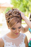 Bride`s Preparation. Bridesmaid helping bride with hairstyle Royalty Free Stock Photos