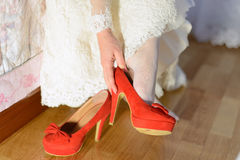 Bride's Red Shoes royalty free stock photography