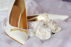 Bride`s shoes. White bride`s shoes with beautiful roses Stock Photography