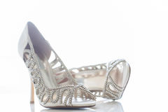 Bride's shoes. Small diamond shoes for the bride on her special day Royalty Free Stock Photography