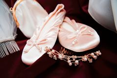 Bride's shoes. A bride's shoes and veil close up stock photography